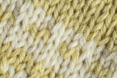 A beautiful closeup of a hand knitted warm and soft wool pattern. Soft socks or scarf of natural wool. Stock Photography