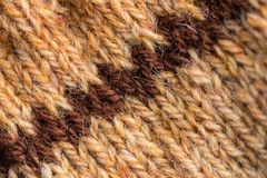 A beautiful closeup of a hand knitted warm and soft wool pattern. Soft socks or scarf of natural wool. Stock Images