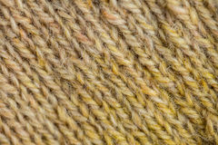 A beautiful closeup of a hand knitted warm and soft wool pattern. Soft socks or scarf of natural wool. Royalty Free Stock Photo