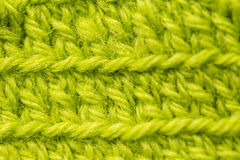 A beautiful closeup of a hand made crochet pattern of a colorful wool yarn. Soft and warm natural sheep wool. Stock Photography
