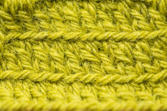A beautiful closeup of a hand made crochet pattern of a colorful wool yarn. Soft and warm natural sheep wool. Royalty Free Stock Photography