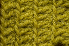 A beautiful closeup of a hand made crochet pattern of a colorful wool yarn. Soft and warm natural sheep wool. Stock Images