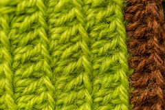 A beautiful closeup of a hand made crochet pattern of a colorful wool yarn. Soft and warm natural sheep wool. Stock Photos