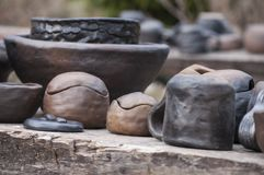 Beautiful closeup of handmade black pottery from clay just taken out from kiln Royalty Free Stock Image