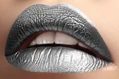 Closeup Lips with frost silver color Makeup. Fashion Celebrate Make-up for New Year. Shiny Christmas Glitter Lip style. Beautiful Closeup Lips with frost silver royalty free stock photo