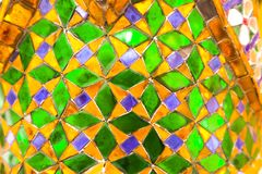 Beautiful closeup textures abstract tiles and gold and colorful glass wall background and art stock photo