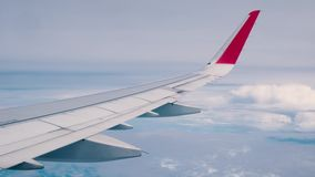 Beautiful cloud and blue sky view from the window of an airplane flying.  stock video footage