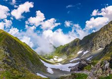 Beautiful cloud formation over the gorgeous ridge. Lovely summer scenery in mountains. Location Fagarasan mountains, Romania Royalty Free Stock Images