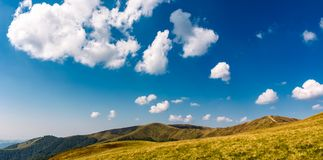 Beautiful cloud formations on a deep blue sky. Lovely panoramic landscape of mountain ridge Stock Photo