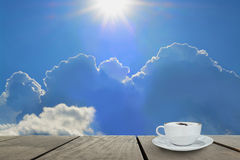Beautiful cloud in morning time with coffee on terrace wood Stock Images