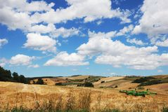 Beautiful Clouds. Italian landscape with straw fields and clouds royalty free stock image