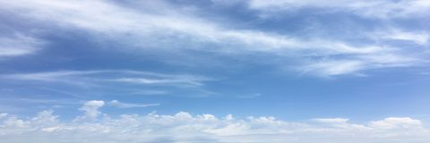 Beautiful clouds against a blue sky background. Cloud sky. Blue sky with clouds weather, nature cloud. White clouds, blue sky and. Sun royalty free stock photos