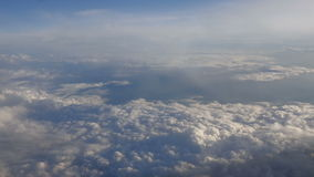 Beautiful clouds through an airplane window (RL Pan, No 6) stock footage