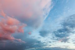 Pink clouds and blue skies at sunset 0167 Stock Image