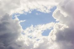 Beautiful clouds and blue sky with space at center from low angle view. royalty free stock image