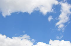 Beautiful clouds. Cleaning the symbol of white clouds and blue sky Royalty Free Stock Image