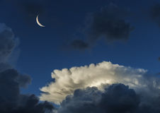 Beautiful clouds and crescent moon Royalty Free Stock Images
