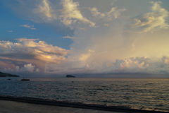 Beautiful clouds in the evening sky. Over the ocean Stock Image