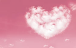 Beautiful clouds in heart shape on pink sky. Love and valentine. Concept. Vintage style stock photos
