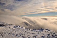 Beautiful clouds in mountains. Dramatic clouds rolling over mountains in winter, Slovakia Small Fatra mountains royalty free stock image