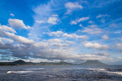Beautiful clouds and ocean with Mt. Kaimon in Kagoshima, Japan. Beautiful clouds and ocean with Mt. Kaimon volcano, Kagoshima, Kyushu, Japan royalty free stock images