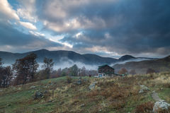 Beautiful clouds over the hut in the mountain Royalty Free Stock Photos