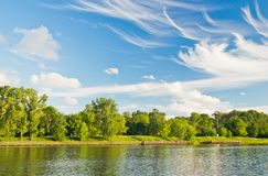 Beautiful clouds over the lake on a summer day Royalty Free Stock Photos