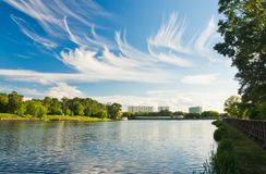 Beautiful clouds over the lake on summer day Stock Image