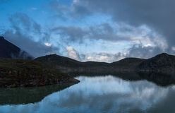 Beautiful clouds over the mountain lake Stock Image