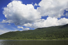 Beautiful clouds over mountain lake Manzherok. Royalty Free Stock Photo