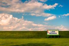 Beautiful clouds over sign for Lake Redman, near York, Pennsylva. Nia Royalty Free Stock Images