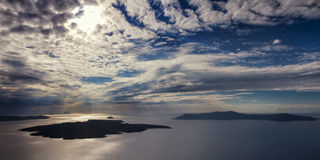 Beautiful clouds over the volcano of Santorini Royalty Free Stock Photo