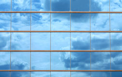 Beautiful clouds reflected in windows Stock Photo