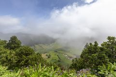 Beautiful clouds in Sao Miguel. Beautiful clouds moving over the pastoral Sete Cidades and Alferes Calderas in Sao Miguel, Azores stock images