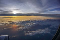 Beautiful clouds in the sky in the morning from the airplane window stock photography