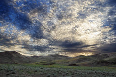Beautiful clouds in steppe at the dawn Stock Images