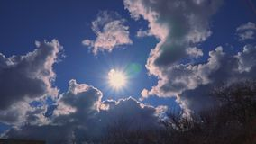 Beautiful clouds and sun in the blue sky.  stock footage
