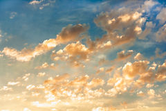 Beautiful clouds at sunset. Beautiful clouds on a blue sky at sunset royalty free stock photography
