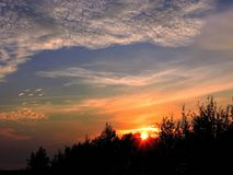 Beautiful clouds and trees in sunset time, lithuania Royalty Free Stock Photo