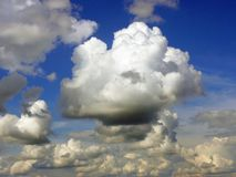 Beautiful clouds. Very beautiful varicoloured clouds on a background brightly blue sky stock photo