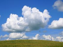 Beautiful clouds. Very beautiful varicoloured clouds on a background brightly blue sky royalty free stock photography