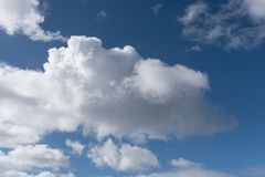 Beautiful cloudscape in blue sky background Stock Image