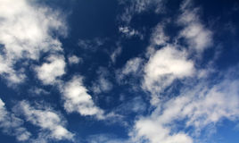 Beautiful cloudscape with blue sky and white clouds. Bright blue skies with many cloud. Shiny spring weather Stock Photography