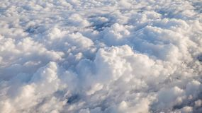 The beautiful cloudscape with clear blue sky. A view from airplane window stock photo