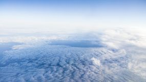 The beautiful cloudscape with clear blue sky. A view from airplane window stock images