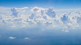 The beautiful cloudscape with clear blue sky. A view from airplane window stock photos