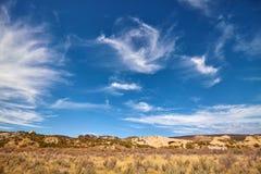Beautiful cloudscape over a barren land, Utah, USA Stock Photos