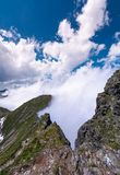 Beautiful cloudscape over the cliffs of Fagarasan. Mountain ridge. lovely nature background on a summer day Royalty Free Stock Images
