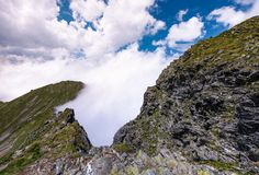 Beautiful cloudscape over the cliffs of Fagarasan. Mountain ridge. lovely nature background on a summer day Stock Image