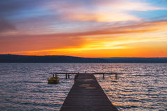Beautiful cloudscape over the lake and blured boat Stock Images